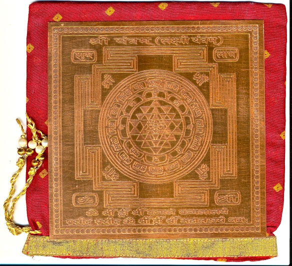 Copper Sri Yantra Chakra.  An auspicious gift, as its energy field is particularly earthing or the cosmic lattice.  Copper is the non-resistant metal of Venus and of electricity.