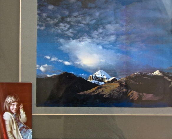 My favourite photo of Mount Kailas, the sacred home of Siva and Parvati.  Kailas is in Tibet, just north of the Gharwal Himalayan whence the Ganges flows.   The photo in the frame is Marisa at about five years old.
