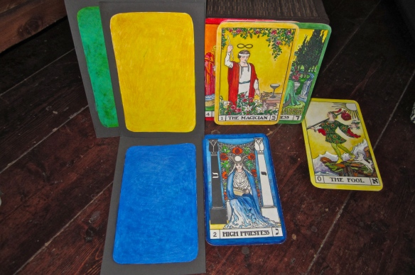 Tarot Keys 1/yellow and 2/blue, with the complementaries green/3 and red/4, showing through.  Additionally - Key 0 the Fool, who is in all the Keys - the adventure of the creative work