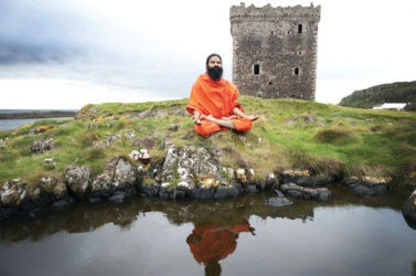 Ramdev meditates at his island off the Scottish coast